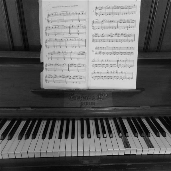 Sheet music on the music holder of a piano.