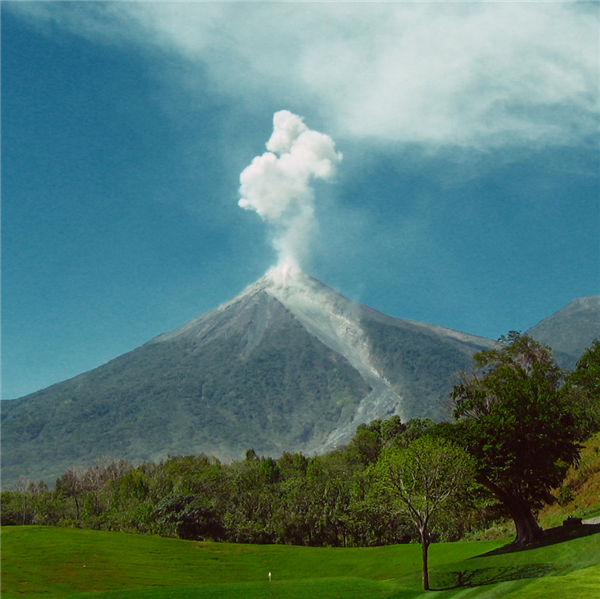 Volcano with smoke coming out of the top