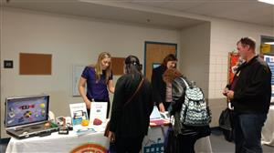 Employees visit one of the many vendors and info booths at the wellness fair