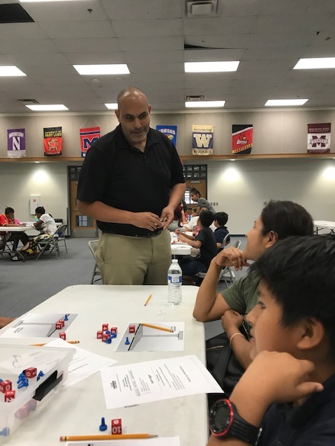Mr. Messieha during math night working with hands on equations.